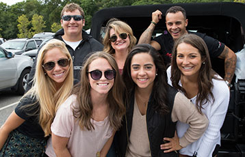 Members of the Bryant community smile during Reunion@Homecoming weekend.
