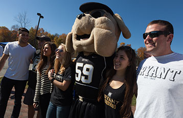 Members of the Bryant community pose with the mascot, Tupper, at Family and Friends Weekend