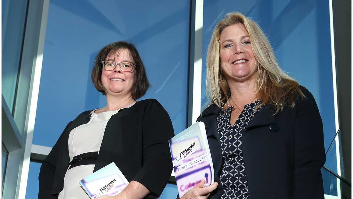 Assistant Dean for Student Success Laurie L. Hazard, Ed.D., and Director of the Academic Center for Excellence Stephanie K. Carter hold the book they co-wrote