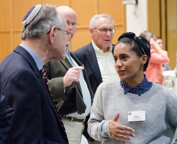 A student confers with a fellow attendee at a Hillel event
