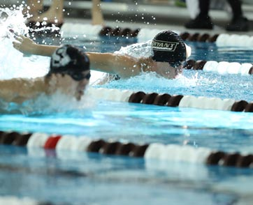 A member of the Bryant swim team competes in a meet