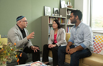 Bryant Rabbi Steven Jablow talks with two students