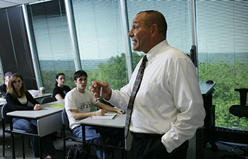 Bryant Professor Stanley Baran lectures in class