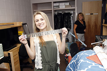 A Bryant student moves in to her dorm room