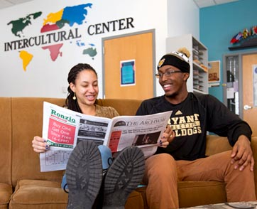 Two students read The Archway at the Intercultural Center